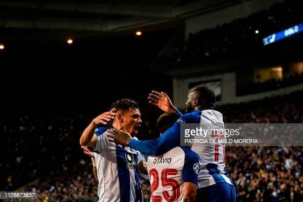 Porto's Brazilian forward Tiquinho Soares celebrates his goal with teammate Porto's Malian forward Moussa Marega during the UEFA Champions League...