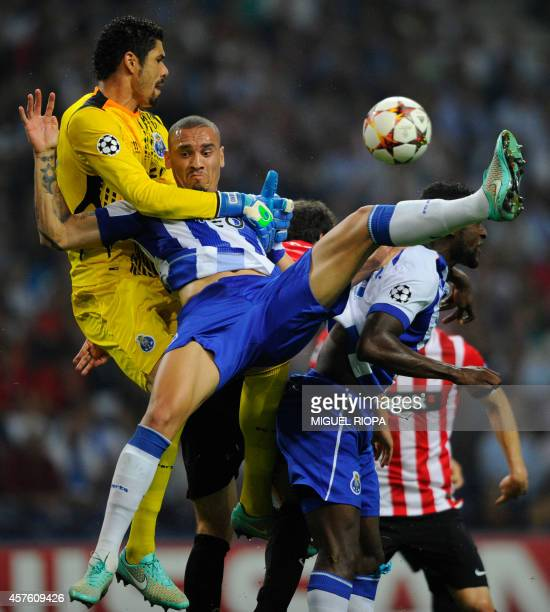Porto's Brazilian goalkeeper Fabiano jumps for a ball with teammates Brazilian defender Maicon during the UEFA Champions League football match FC...