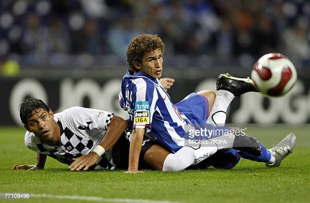 FC Porto's brazilian Leandro Lima vies with Boavista's angolan Moises Pinheiro during their portuguese Super League football match at the Dragaol...