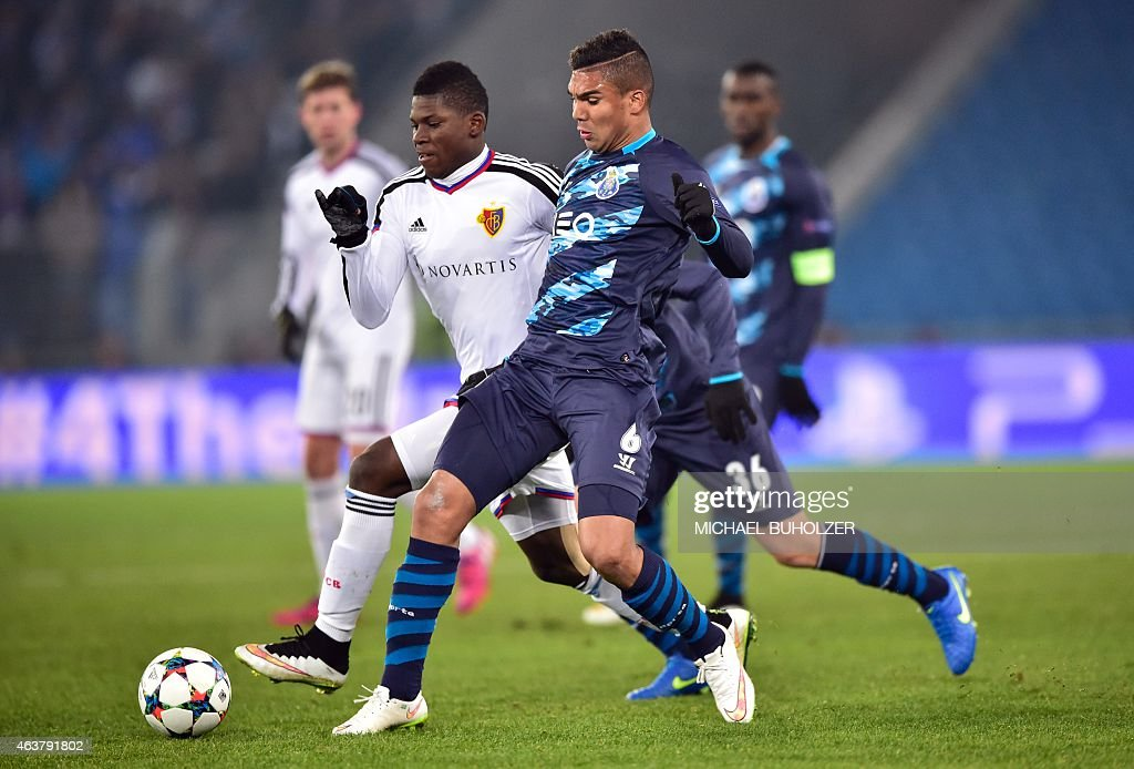 Porto's Brazilian midfielder Casemiro (R) vies with Basel's Swiss forward Breel Embolo during the UEFA Champions League round of 16 first leg football match between Basel (FCB) and Porto (FCP) on February 18, 2015 at the St. Jakob-Park stadium in Basel.