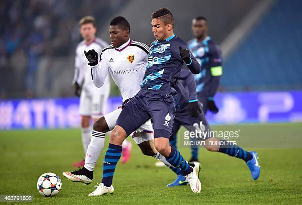 Porto's Brazilian midfielder Casemiro vies with Basel's Swiss forward Breel Embolo during the UEFA Champions League round of 16 first leg football...