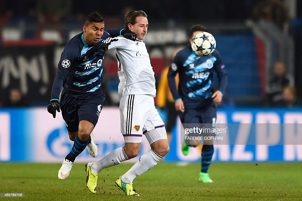 Porto's Brazilian midfielder Casemiro (L) vies with Basel's Swiss midfielder Luca Zuffi during the UEFA Champions League round of 16 first leg football match between Basel (FCB) and Porto (FCP) on February 18, 2015 at the St. Jakob-Park stadium in Basel.