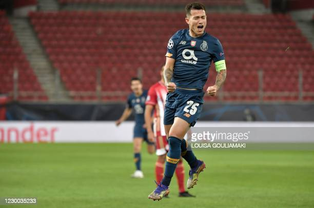 Porto's Brazilian midfielder Otavio celebrates after scoring a goal during the UEFA Champions League Group C football match between Olympiakos and FC...