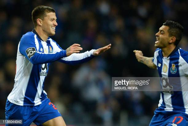Porto's Brazilian midfielder Otavio celebrates his goal with teammate Mexican forward Jesus Corona during the Portuguese league football match...