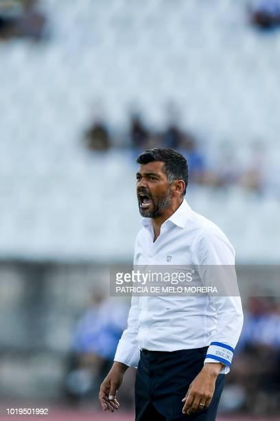 Porto's Brazilian midfielder Otavio celebrates with teammates after scoring a goal during the Portuguese League football match between Os Belenenses...