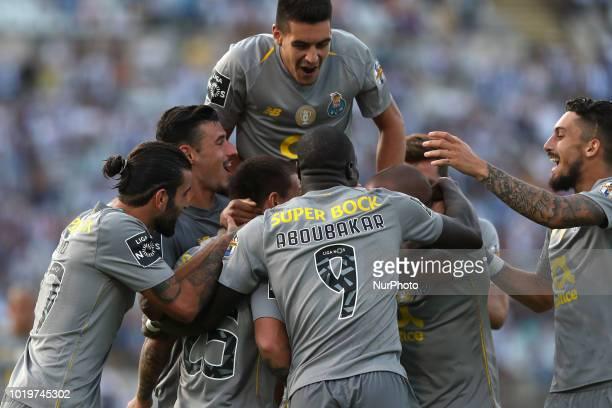Porto's Brazilian midfielder Otavio celebrates with teammates after scoring during the Portuguese League football match Belenenses vs FC Porto at the...