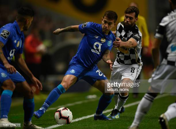 Porto's Brazilian midfielder Otavio challenges Boavista's Portuguese midfielder David Simao during the Portuguese league football match between...
