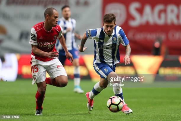 Porto's Brazilian midfielder Otavio in action with Braga's Brazilian defender Baiano during the Premier League 2016/17 match between SC Braga and FC...