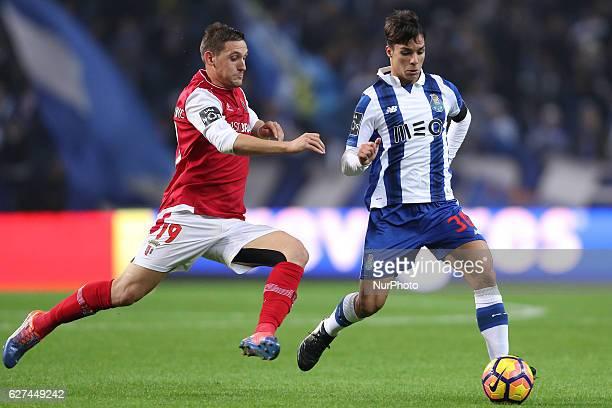 Porto's Brazilian midfielder Otavio in action with Braga's Serbian forward Nikola Stojiljkovic during the Premier League 2016/17 match between FC...