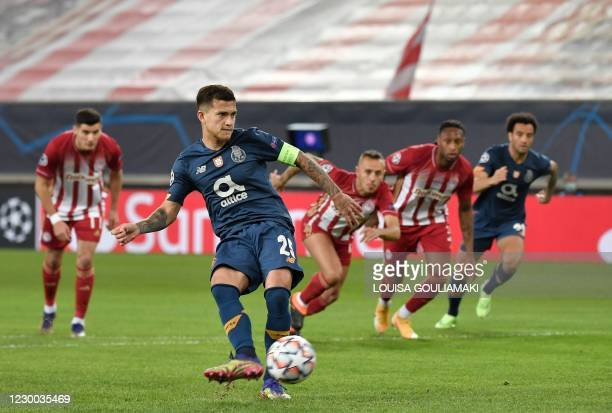 Porto's Brazilian midfielder Otavio takes a penalty kick and scores a goal during the UEFA Champions League Group C football match between Olympiakos...