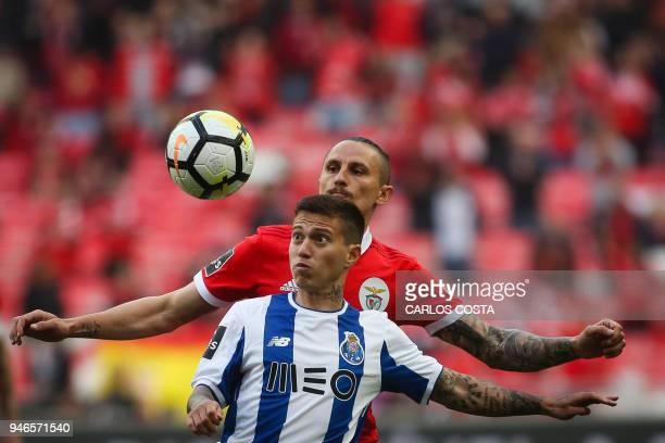 Porto's Brazilian midfielder Otavio vies with Benfica's Serbian midfielder Ljubomir Fejsa during the Portuguese league footbal match between SL...