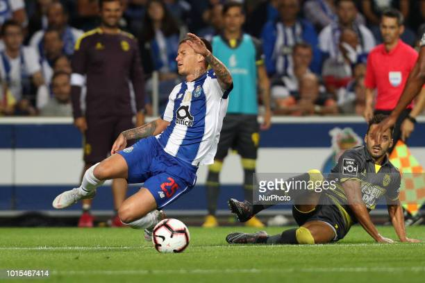 Porto's Brazilian midfielder Otavio vies with GD Chaves Portuguese defender Luis Martins in action during the Premier League 2018/19 match between FC...