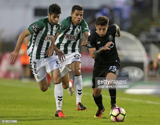 Porto's Brazilian midfielder Otavio vies with Setubals midfielder Fabio Pacheco and defender Geraldes de Barros during the Portuguese league football...