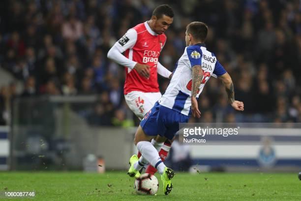 Porto's Brazilian midfielder Otavio vies with Sporting Braga's Brazilian defender Pablo Santos during the Premier League 2018/19 match between FC...