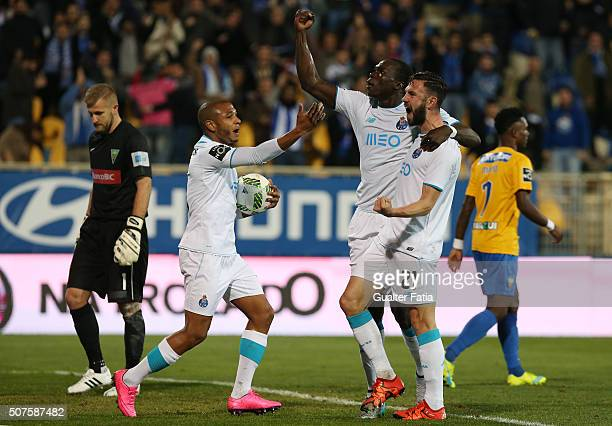 Porto's cameroon forward Vincent Aboubakar celebrates with teammate FC Porto's mexican defender Miguel Layun after scoring a goal during the Primeira...