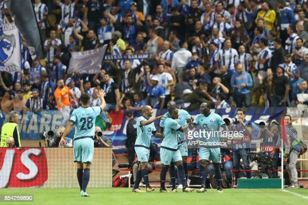 Porto's Cameroonian forward Aboubakar celebrates after scoring a goal with his teammates during the UEFA Champions League Group G football match AS...