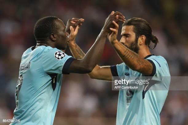 Porto's Cameroonian forward Aboubakar celebrates after scoring a goal with Porto's Portuguese midfielder Sergio Oliveira during the UEFA Champions...