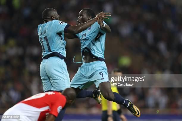 Porto's Cameroonian forward Aboubakar celebrates after scoring a goal with Porto's Malian forward Moussa Marega during the UEFA Champions League...