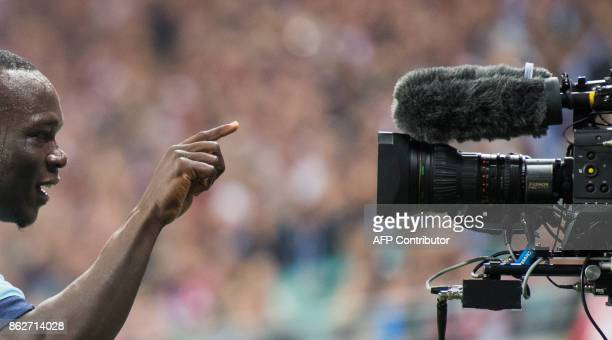 Porto's Cameroonian forward Aboubakar gestures into a pitch camera after scoring during the UEFA Champions League group G football match RB Leipzig v...