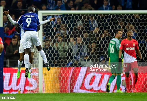 Porto's Cameroonian forward Vincent Aboubakar celebrates a goal with Porto's Algerian forward Yacine Brahimi during the UEFA Champions League group G...
