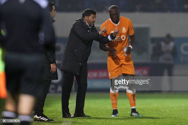 Porto's Cameroonian forward Vincent Aboubakar celebrates after scoring a goal with Porto's Portuguese head coach Sergio Conceicao during the Premier...