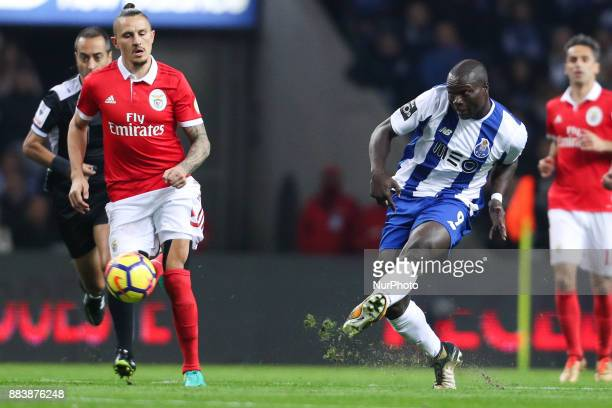 Porto's Cameroonian forward Vincent Aboubakar in action with Benfica's Serbian midfielder Ljubomir Fejsa during the Premier League 2016/17 match...