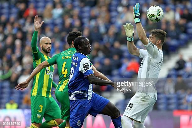 Porto's Cameroonian forward Vincent Aboubakar in action with CD Tondela's Brazilian defender Kaká and CD Tondela's Portuguese goalkeeper Cláudio...