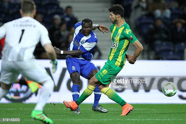 Porto's Cameroonian forward Vincent Aboubakar in action with CD Tondela's Brazilian defender Kaká during the Premier League 2015/16 match between FC...