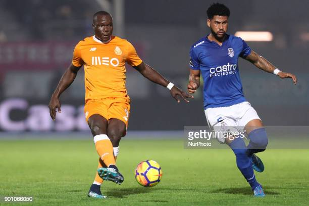 Porto's Cameroonian forward Vincent Aboubakar in action with Feirense's midfielder Babanco during the Premier League 2016/17 match between CD...