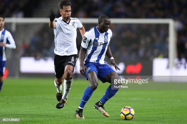 Porto's Cameroonian forward Vincent Aboubakar in action with Francisco Ramos of Vitoria SC during the Premier League 2017/18 match between FC Porto...