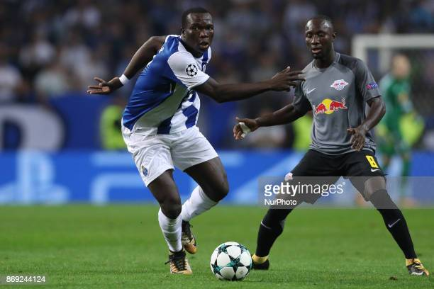 Porto's Cameroonian forward Vincent Aboubakar in action with Midfielder Naby Keita of Leipzig during the UEFA Champions League Group G match between...