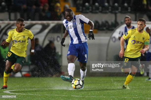 Porto's Cameroonian forward Vincent Aboubakar in action with Pacos Ferreira's midfielder Assis and Pacos Ferreira's Portuguese midfielder Pedrinho...