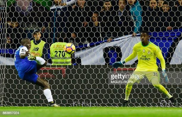Porto's Cameroonian forward Vincent Aboubakar misses a goal in front of Benfica's Portuguese goalkeeper Bruno Varela during the Portuguese league...