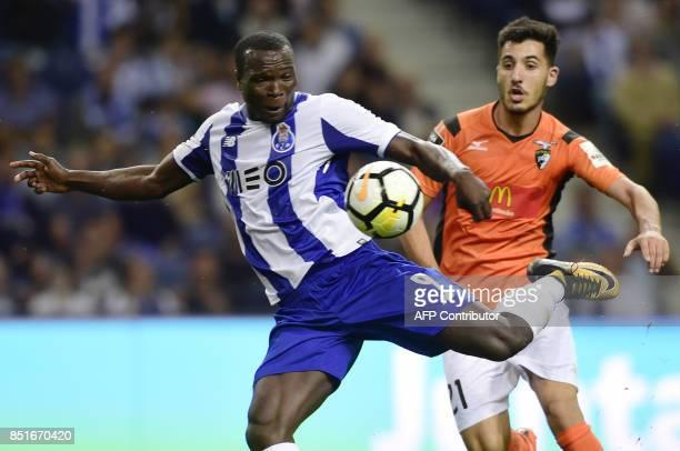 Porto's Cameroonian forward Vincent Aboubakar shoots to score a goal beside Portimonense's midfielder Pedro Sa during the Portuguese league football...