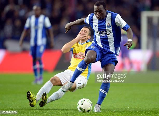 Porto's Cameroonian forward Vincent Aboubakar vies with Arouca's midfielder Artur Moreira during the Portuguese League football match FC Porto vs FC...