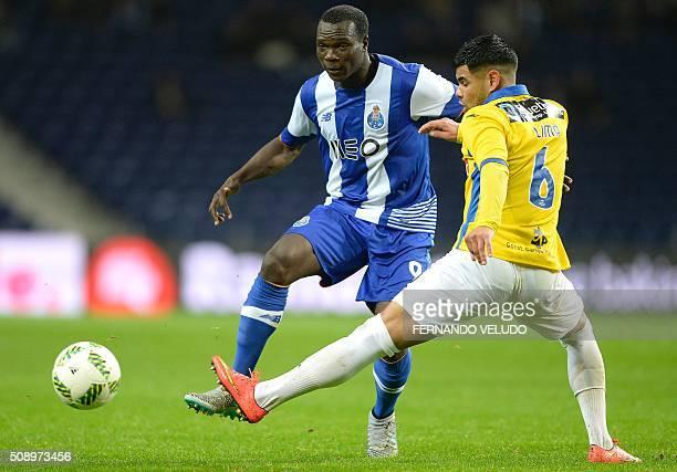Porto's Cameroonian forward Vincent Aboubakar vies with Arouca's Brazilian defender Lucas Lima during the Portuguese League football match FC Porto...