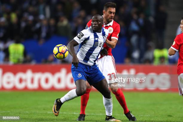 Porto's Cameroonian forward Vincent Aboubakar vies with Benfica's Brazilian defender Jardel during the Premier League 2016/17 match between FC Porto...