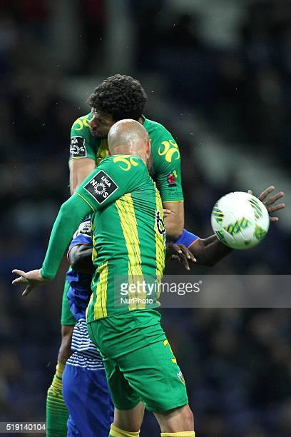 Porto's Cameroonian forward Vincent Aboubakar vies with CD Tondela's Brazilian defender Kaká and CD Tondela's Portuguese defender João Pica during...