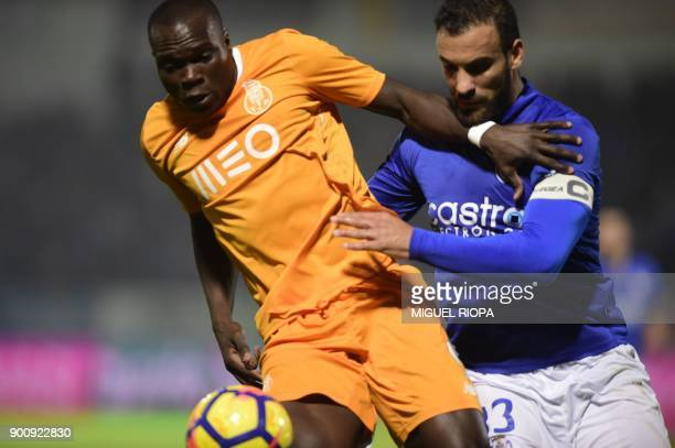 Porto's Cameroonian forward Vincent Aboubakar vies with Feirense's Portuguese defender Luis Rocha during the Portuguese league football match CD...