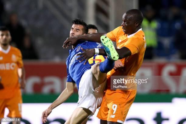 Porto's Cameroonian forward Vincent Aboubakar vies with Feirense's Portuguese forward Luis Aurelio during the Premier League 2016/17 match between CD...
