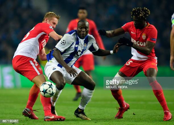 Porto's Cameroonian forward Vincent Aboubakar vies with Monaco's Polish defender Kamil Glik and teammate French defender Kevin N'Doram during their...