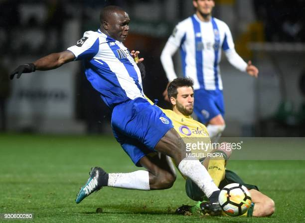 Porto's Cameroonian forward Vincent Aboubakar vies with Pacos de Ferreira's Portuguese defender Rui Correia during the Portuguese league football...