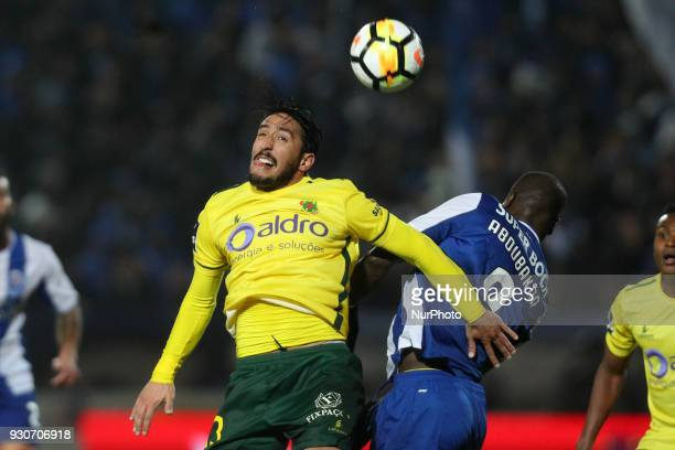 Porto's Cameroonian forward Vincent Aboubakar vies with Pacos Ferreira's Portuguese defender Joao Gois during the Premier League 2017/18 match...