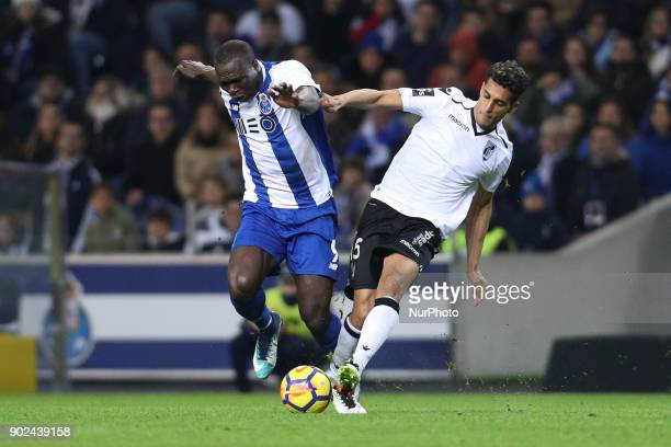 Porto's Cameroonian forward Vincent Aboubakar vies with Victor Garcia of Vitoria SC during the Premier League 2017/18 match between FC Porto and...