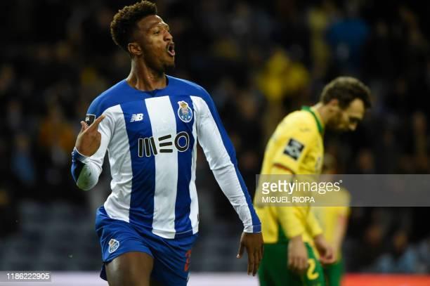 Porto's Cape Verdean forward Ze Luis celebrates after scoring a goal during the Portuguese league football match between FC Porto and FC Pacos de...