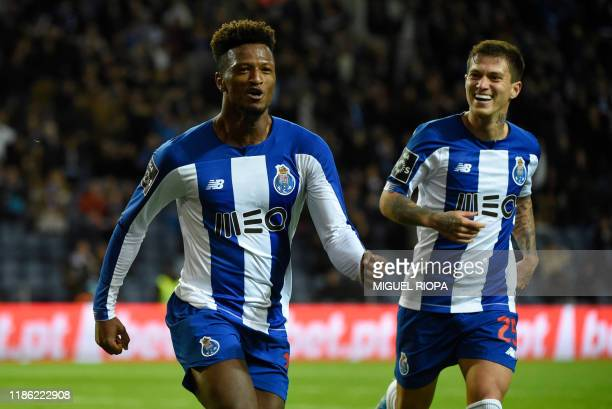 FC Porto's Cape Verdean forward Ze Luis celebrates his goal with teammate Brazilian midfielder Otavinho during the Portuguese league football match...