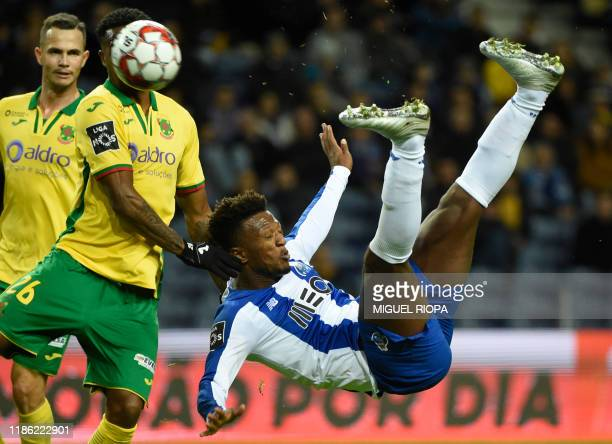Porto's Cape Verdean forward Ze Luis kicks the ball to score a goal during the Portuguese league football match between FC Porto and FC Pacos de...