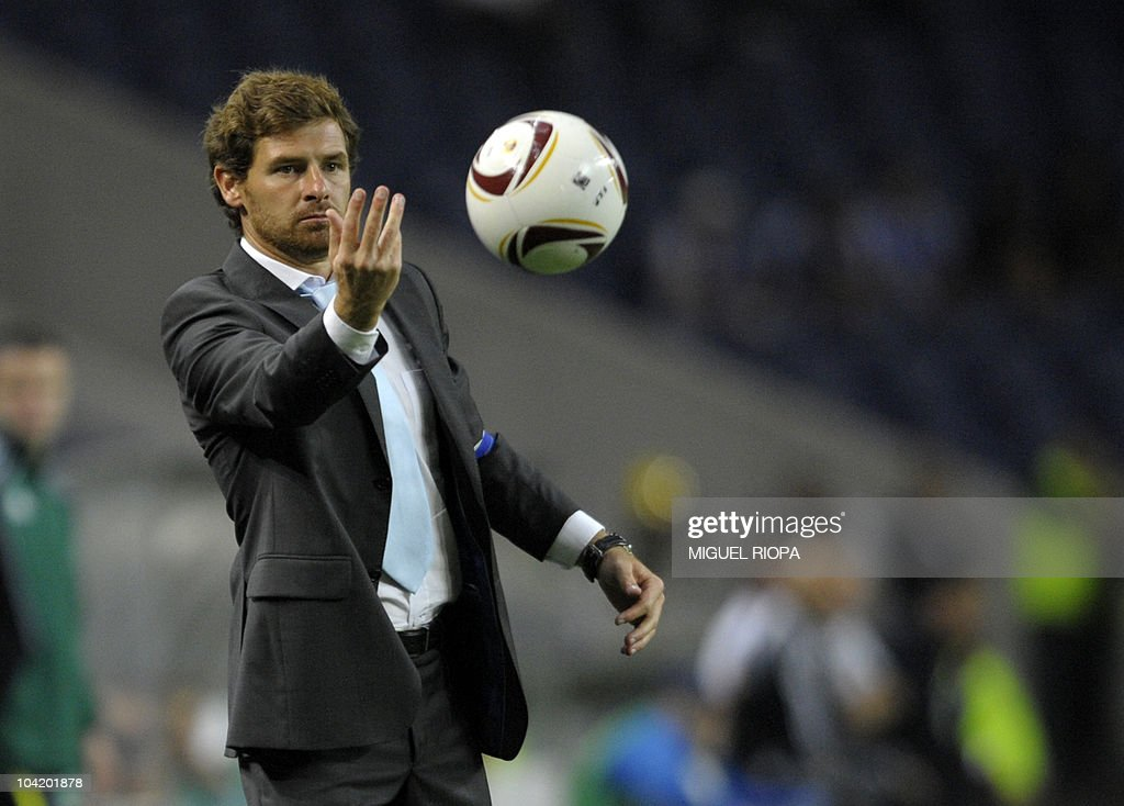 FC Porto's coach Andre Villas Boas passes the ball to a player during their UEFA Europa League football match against Rapid Vienna at the Dragao Stadium in Porto, on September 16, 2010. Porto won 3-0.