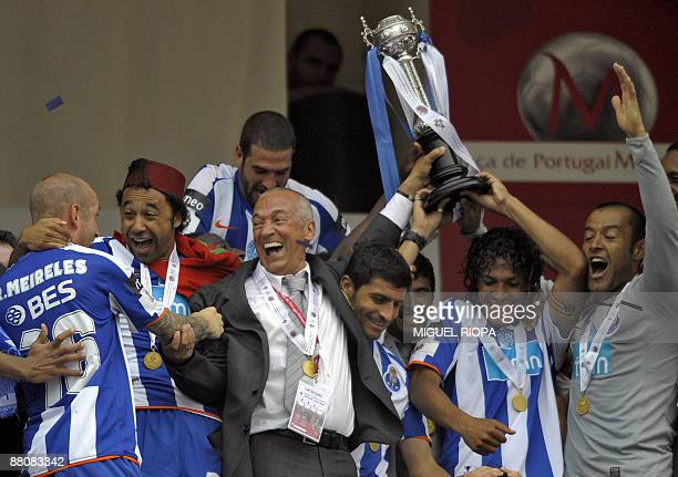 FC Porto's coach Jesualdo Ferreira celebrates with his players after winning the Portugal's Cup final football match against Pacos Ferreira on May 31...