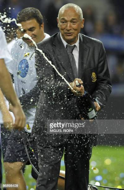Porto's coach Jesualdo Ferreira sprays champagne at the end of their Portuguese First league football match against CD Nacional at the Dragao Stadium...